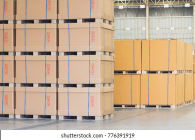 cardboard boxes are stacked on wooden palette in cargo, finish products are ready to delivery from transportation logistics in storage warehouse