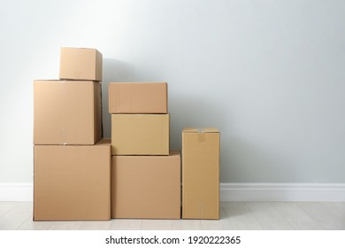 Cardboard boxes with stuff indoors, space for text. Moving day