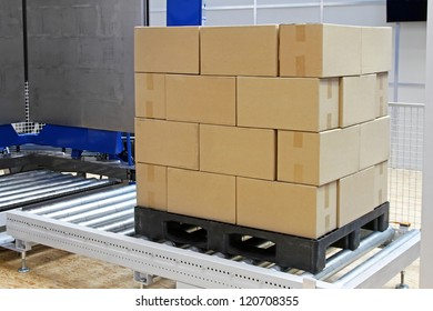 Cardboard boxes at transport pallet package