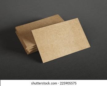 Cardboard business cards on dark background