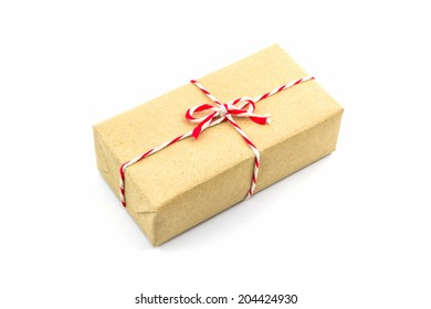 Cardboard carton wrapped with brown paper, tied with string on white background.