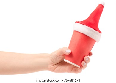A cardboard coffee cups snowing winter New Year Santa Claus in hands on a white background isolation