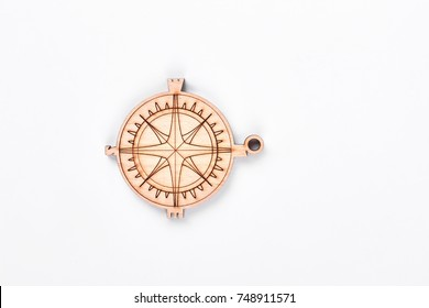 Cardboard compass on white background. Handmade figure of compass made from wood isoalted on white backgrounnd.