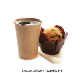 Cardboard cup of coffee and muffin on white background. Space for design