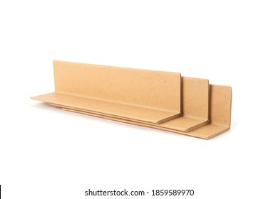 Cardboard edge protectors isolated on white - corner-edge protection while transportation goods. Recyclable packaging products