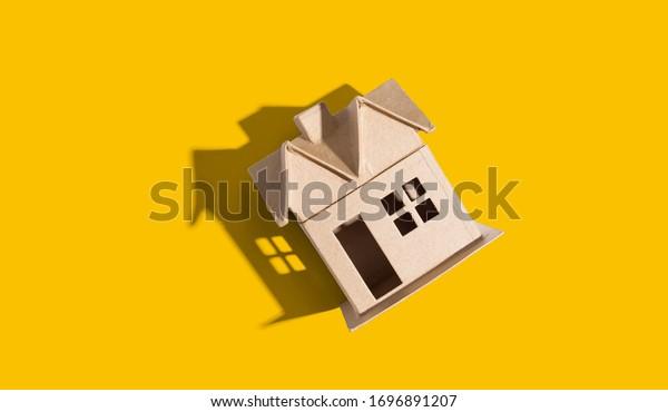 Cardboard house with drop shadow overhead view