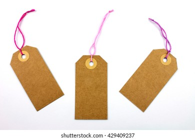 Cardboard Labels with Pink Thread Isolated.