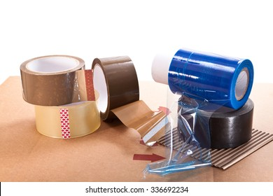 Cardboard for packaging, adhesive tape and nylon on a white background