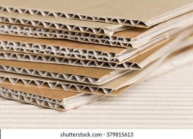 Cardboard pile on corrugated cardboard texture