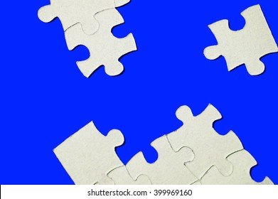 cardboard puzzles pieces on a blue background