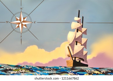 Cardboard ship against the sky. Theme nautical fairy tales. Illustration. Wind rose as a symbol of the course.