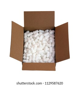 Cardboard shipping box filled with packing styrofoam peanuts, isolated on white