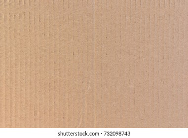 Cardboard texture. Abstract background of a sheet of paper with vertical stripes, lines.