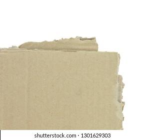 cardboard torn edge. cardboard background isolated on white. Piece of corrugated cardboard torn, isolated on white background. Cardboard texture ragged edge.