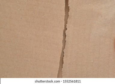 Cardboard with torn edges arranged in superimposed layers.