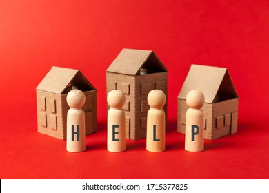 Cardboard toy houses on red background with help sign. Falling property prices. Economic depression.