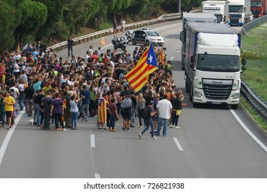 Cardedeu, Catalonia, Spain, October 3, 2017: paceful people cutting off the highway AP-7 in protest for spanish police repression of first october