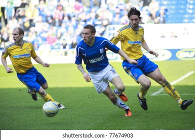 CARDIFF - APRIL 02: Craig Bellamy (middle) of Cardiff City FC dribble past Derby County FC defense during their Championship match, April 02, 2011 in Cardiff, Wales.