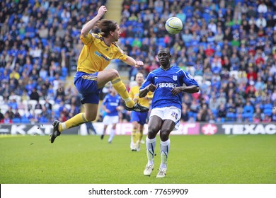 CARDIFF - APRIL 2: Shaun Barker (left) of Derby County FC challenges Seyi Olofinjana (right) of Cardiff City FC during their Championship match in Cardiff, April 2, 2011 in Wales, UK.