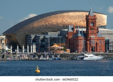 Cardiff Bay, Pierhead Building, Wales Millennium Centre, taken on a sunny summer's day, with the sun bouncing off the copper roof of the Millennium Centre.