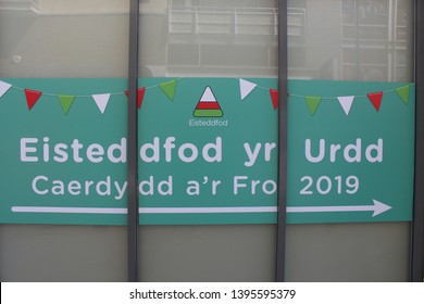 Cardiff Bay, Cardiff, United Kingdom - 10 May 2019: Advertising on a window for the Urdd Eisteddfod (youth festival) to be held in Cardiff Bay in May 2019.