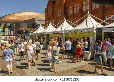 CARDIFF BAY, CARDIFF, WALES  - JULY 2018: People walking around the stalls at the Cardiff Food Festival In Cardiff Bay.