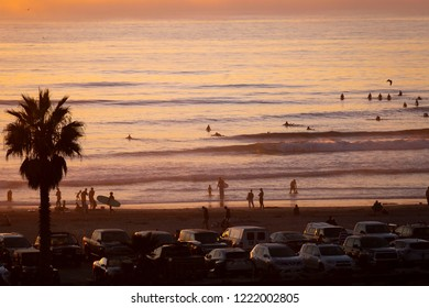 Cardiff, California / USA 11- 03-2018 Surfers and beachgoers enjoy the world famous surf destination of Cardiff Reef  in Cardiff by the Sea California.
