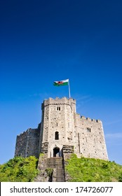 Cardiff Castle, welsh flag flying, situated within beautiful parklands in the heart of the city.