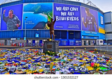 Cardiff, Cardiff County / Wales UK - 2/1/2019:Recent tragic loss of new signing Emiliano Sala in plane crash from Nantes. Fan's salute player with floral tributes outside Cardiff City's Stadium.
