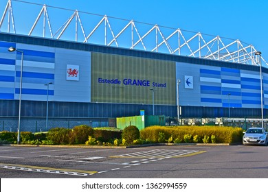 Cardiff, Cardiff County / Wales UK - 3/29/2019: Cardiff City Football Club stadium.View of Grange Stand with Cardiff Bluebird symbol, & Welsh Dragon.