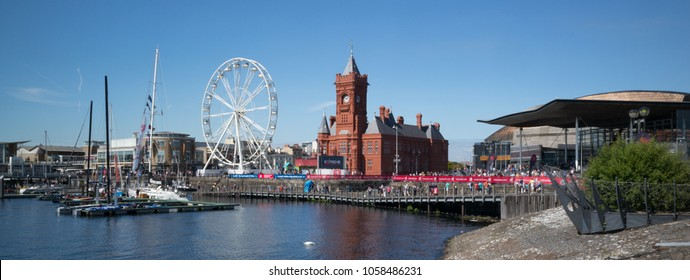Cardiff / GB - August 27 2017: Pierhead building, ferris wheel (to left), and Senedd (to right) at Cardiff Bay during August Bank Holiday weekend