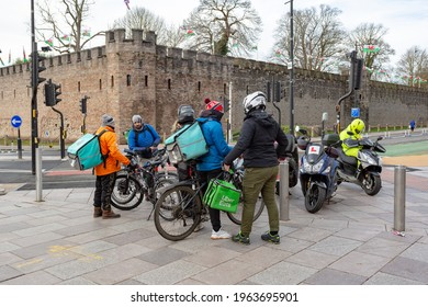 Cardiff, Gwent, Wales - February 3rd 2021: Deliveroo and Uber Eats riders gather together
