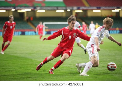 CARDIFF - SEPTEMBER 9: Aaron Ramsey (left) of Wales and Alexei Rebko (right) of Russia in action during their World Cup 2010 qualifying match September 9, 2009 in Cardiff, Wales. Russia won 3-1.
