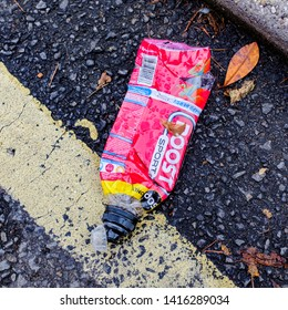 Cardiff, UK. 2nd June 2019. Discarded and flattened Boost energy drink plastic bottle.