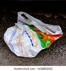 Cardiff, UK. 2nd June 2019. Discarded plastic shopping bag from Tesco, lying in the street.