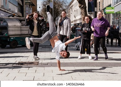 Cardiff, UK. April 2018. Members of the Jukebox Collective Dance Group performing in Queen Street, Cardiff.