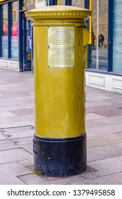 Cardiff, UK. April 2019.  Post box painted gold to honour Geraint Thomas, who won a gold medal for GB in the cycling team pursuit race at the 2012 London Olympics. Thomas won the 2018 Tour de France.
