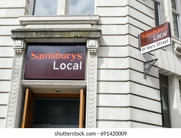 Cardiff, UK: August 05, 2016: Entrance door to a Sainsbury's Local. These popular smaller versions of the bigger Sainsbury's stores, stock many of the essential items somebody would need.