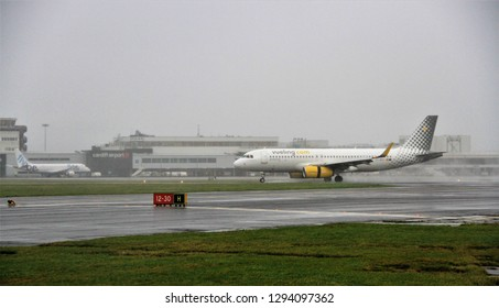 Cardiff uk January 12 2019 vueling passenger jet landing in bad weather at Cardiff airport