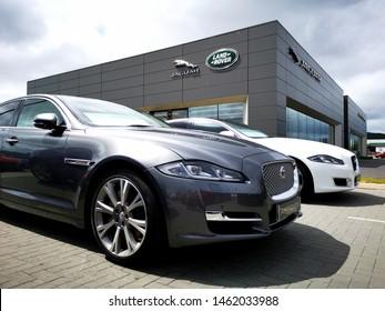 Cardiff, UK: July 20, 2019: Used Jaguar XJ car for sale outside a Jaguar Land Rover showroom. Jaguar Land Rover Limited is a British multinational automotive company.