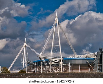 Cardiff, UK - Oct 22, 2019: Two of the four white cable-stayed truss masts at the Cardiff Millennium / Principality Stadium - the four masts are 94m tall.