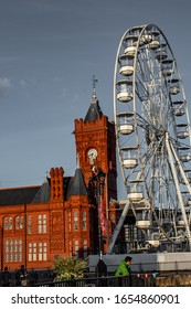 Cardiff, UK - Sept 05, 2019 / Cardiff bay wheel, Pierhead old building in background