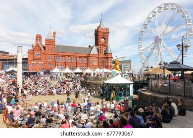 Cardiff, United Kingdom -  July 14, 2017: People are enjoying themselves on the opening day of the Cardiff International Food Festival 2017 at Roald Dahl Plass, Cardiff Bay, Cardiff, Wales, UK.