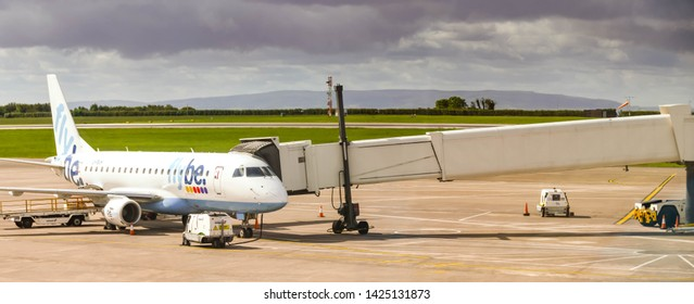 CARDIFF WALES AIRPORT - JUNE 2019: Flybe Embraer E175 plane attached to a jet bridge  at Cardiff Wales Airport. The airline is now owned by Connect Airways having been bought out in 2019.