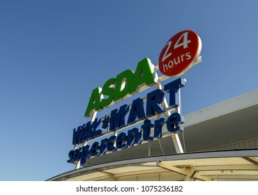 CARDIFF, WALES - APRIL 2018: Large sign with the company name above the entrance to the Asda superstore In Coryton in a suburb of the city