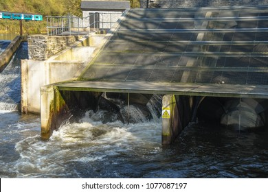 CARDIFF, WALES - APRIL 2018:   Water flowing out of an Archimedes Screw Turbine at the hydro electric plant on the River Taff at Radyr
