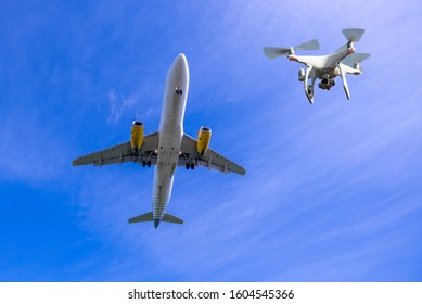 Cardiff, Wales - April 26, 2018. Unmanned drone flying near  commercial airplanes landing at airport, flight disruption concept