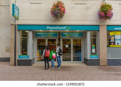 Cardiff, Wales - Aug 27, 2018: Entrance to Poundland Shop Cardiff, view from Queen Street, Discount retail chain, horizontal photography