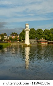 CARDIFF, WALES - AUGUST 2018: Wide angle view of The Scott Memorial in Roath Park Lake in Cardiff.  Captain Scott sailed from Cardiff on his expedition to reach the South Pole.