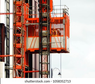 Cardiff, Wales - March 2018: Landscape view of an elevator carrying workers up the side of a building under construction